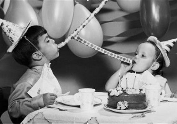 black and white photograph of children celebrating birthday