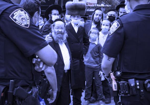 Photograph of members of the Orthodox Jewish community facing NY police officers