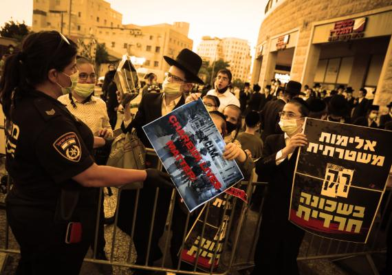 """haredi Jews protesting with sign that says, """"Charedi Lives Matter"""""""