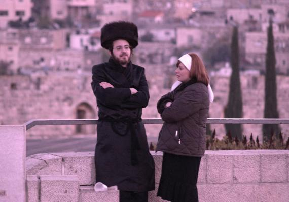 photograph of haredi couple in Jerusalem with pink filter