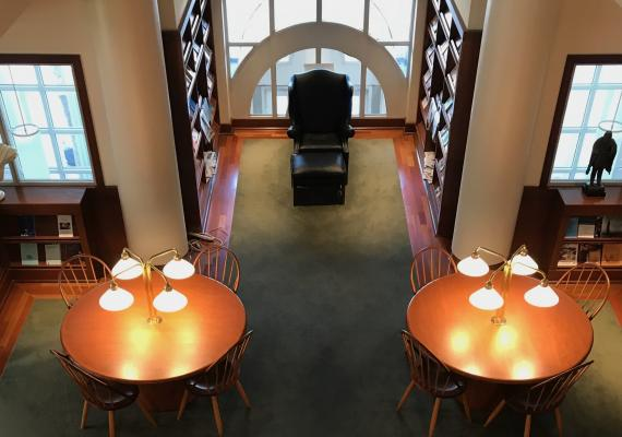 aerial view of the Reading Room in the Library at the Katz Center, showing four tables with lamps