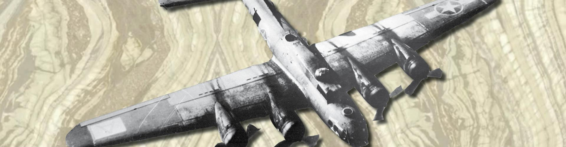 black and white ww2 plane atop marble background